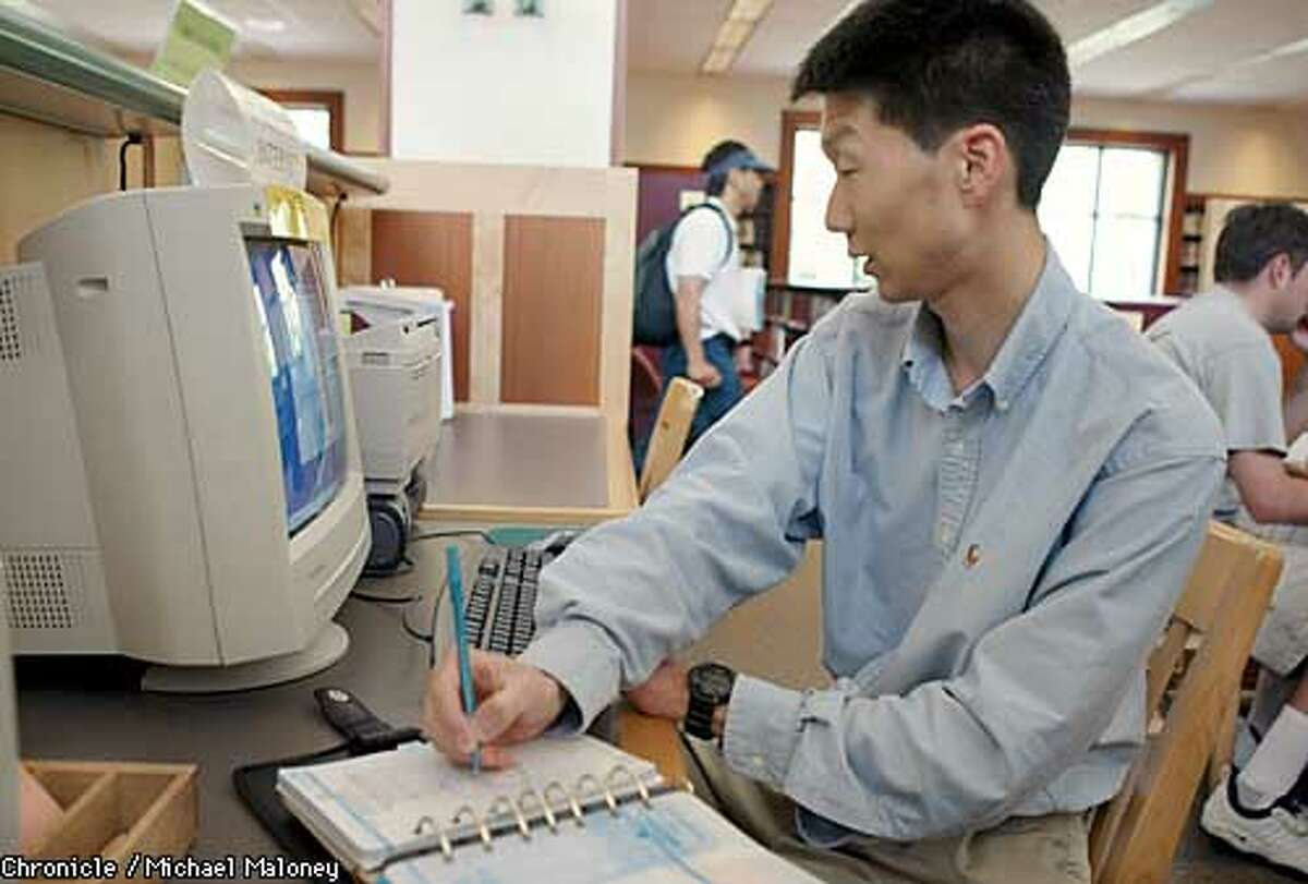 Daniel Soong of Pleasanton uses a computer at the Danville Public Library to search for job openings.