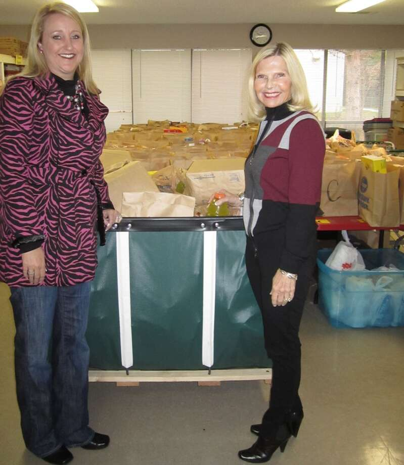 Kerri Chaney (left), publisher of Kidnnected Magazine, stands with Dr. Ann Snyder, president and CEO of Interfaith of The Woodlands, to demonstrate the need for food donations to Interfaith's food bank program.