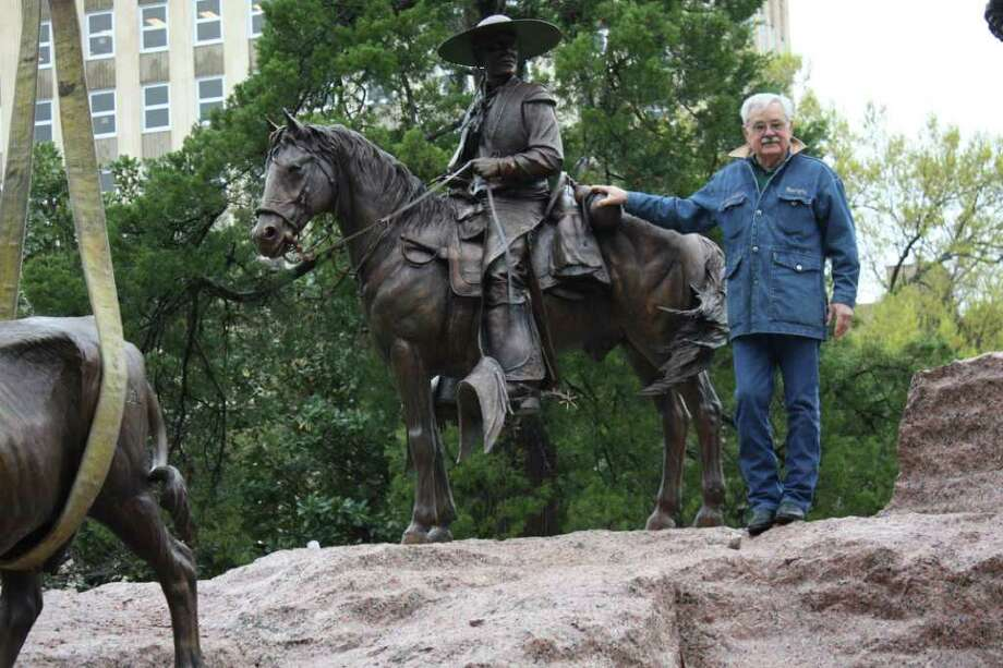 IBC Bank – Zapata CEO & President and VP of the Tejano Monument Board of Directors Renato Ramirez stands with one of the statues of the Tejano Monument that is being finalized for the March 29 unveiling at the Texas State Capitol. Photo: Courtesy Photo