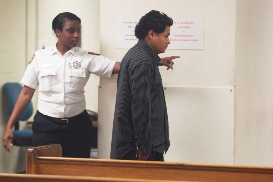 Luis Hector Lopez-Rodriguez walks into his initial appearance at the magistrate court. (Johnny Hanson/Chronicle)