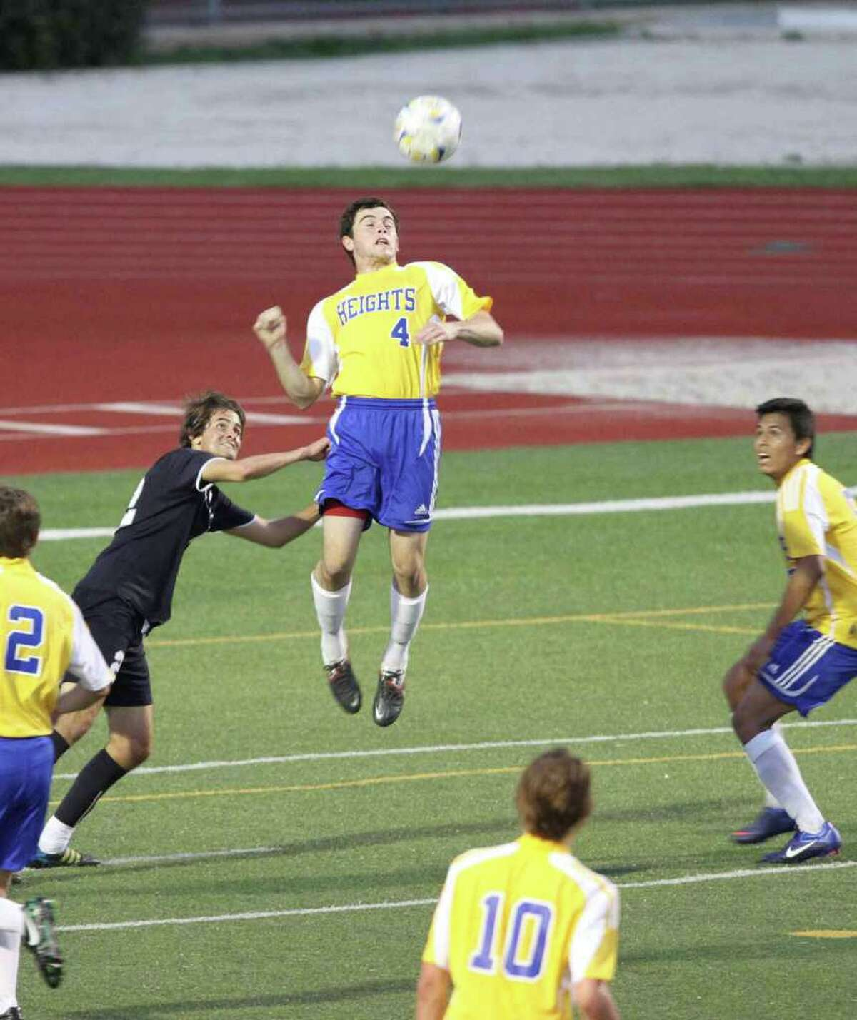 Alamo Heights senior Alek Strimple clears the ball away from Boerne Champion's Matt Dorsey. No. 6 Heights shut out the No. 5 Chargers, 3-0, March 13 at Orem Stadium in a key district battle.