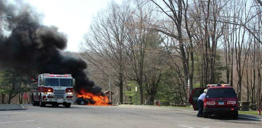Firefighters battled a car fire at the Exit 2 rest area on Monday, March 19, 2012. Photo: Contributed Photo