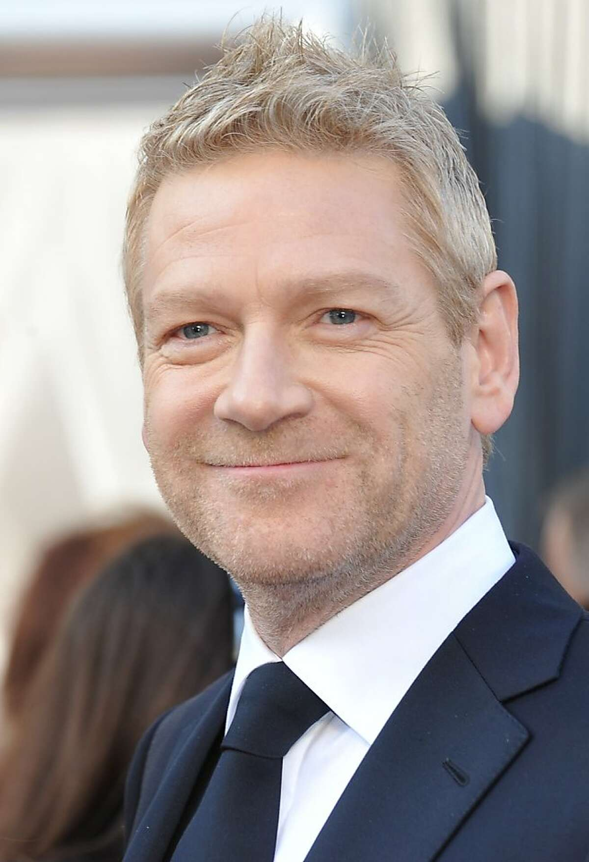 Actor Kenneth Branagh arrives on the red carpet for the 84th Annual Academy Awards on February 26, 2012 in Hollywood, California. AFP PHOTO Joe KLAMAR (Photo credit should read JOE KLAMAR/AFP/Getty Images)