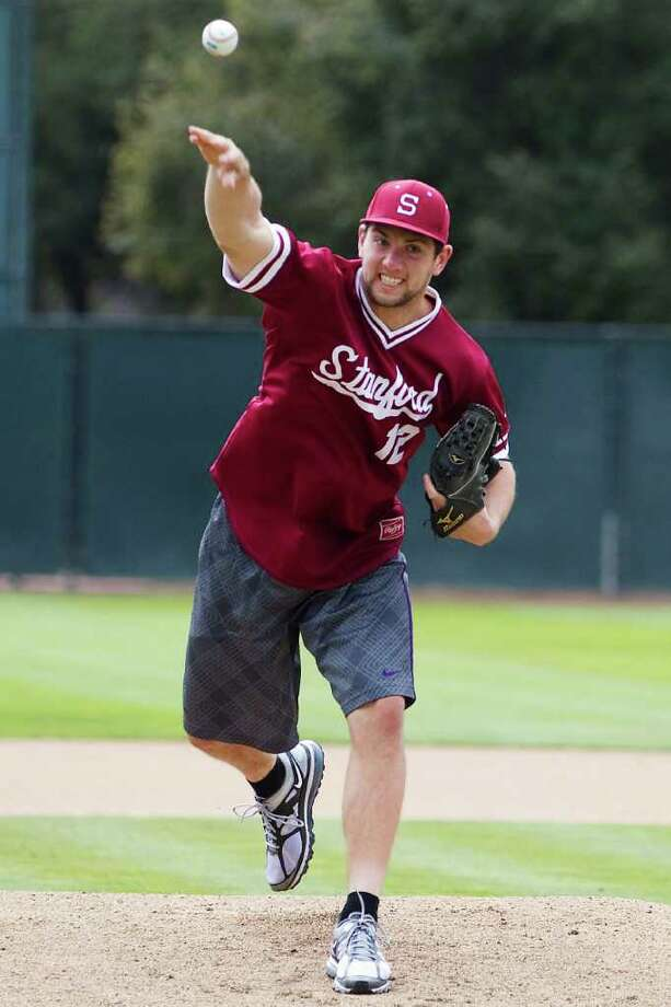 In this March 11, 2012 photo provided by Stanford University, former Stanford quarterback Andrew Luck throws out the ceremonial first pitch before an NCAA college baseball game between Stanford and Rice in Stanford, Calif. Luck is set to become the NFL's No. 1 draft pick next month. Stanford pitcher Mark Appel is slated to go first in June's amateur baseball draft. That's already figuring to be quite a feat for the school. Add women's basketball star Nnemkadi Ogwumike into the mix as the probable top pick in the WNBA draft, and it very well could be a remarkable Cardinal three-fer. Photo: AP