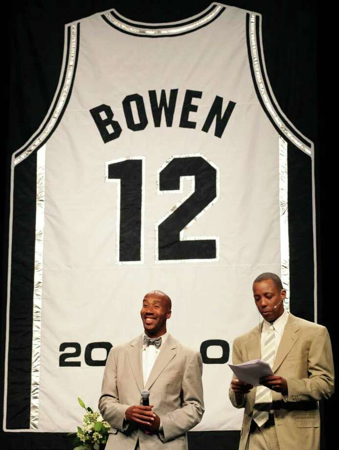 Former Spurs Bruce Bowen, left, smiles as former Spurs Sean Elliott introduces him at the Jersey Retirement Luncheon for Bowen at the ATT Center, Monday, March 19, 2012.  Bob Owen/San Antonio Express-News. Photo: BOB OWEN, San Antonio Express-News / © 2012 San Antonio Express-News