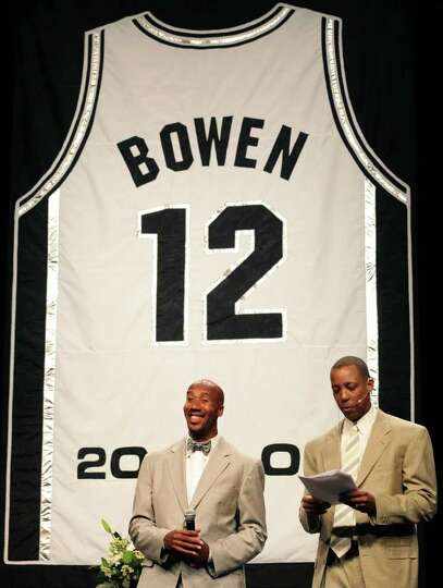 Former Spurs Bruce Bowen, left, smiles as former Spurs Sean Elliott introduces him at the Jersey
