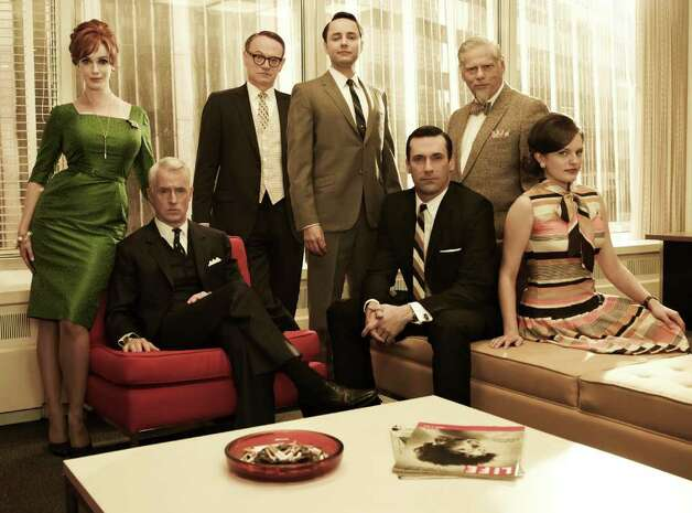 (L-R) Joan Harris (Christina Hendricks), Roger Sterling (John Slattery), Lane Pryce (Jared Harris), Pete Campbell (Vincent Kartheiser), Don Draper (Jon Hamm), Bertram Cooper (Robert Morse) and Peggy Olson (Elisabeth Moss) - Mad Men - Season 5 - Gallery - Photo Credit: Frank Ockenfels/AMC Photo: Frank Ockenfels/AMC / Copyright: AMC 2012