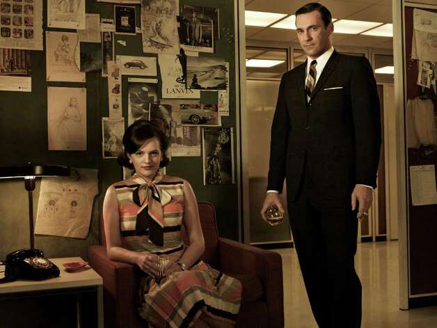 Peggy Olson (Elisabeth Moss) and Don Draper (Jon Hamm) - Mad Men - Season 5 - Gallery - Photo Credit: Frank Ockenfels/AMC Photo: Frank Ockenfels/AMC / Copyright: AMC 2012