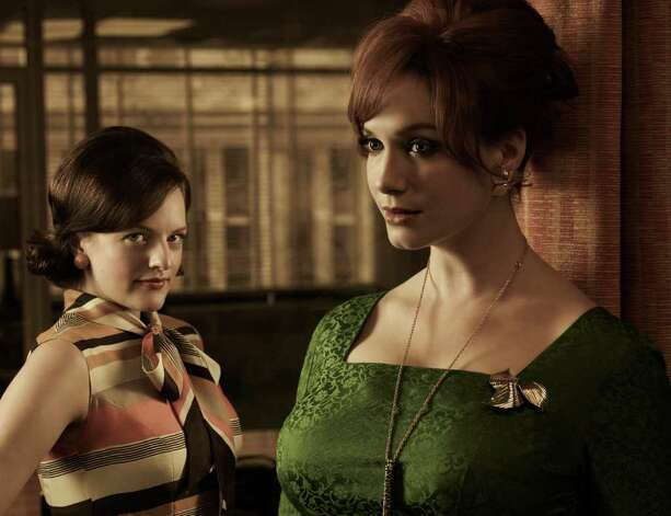 Peggy Olson (Elisabeth Moss) and Joan Harris (Christina Hendricks) - Mad Men - Season 5 - Gallery - Photo Credit: Frank Ockenfels/AMC Photo: Frank Ockenfels/AMC / Copyright: AMC 2012
