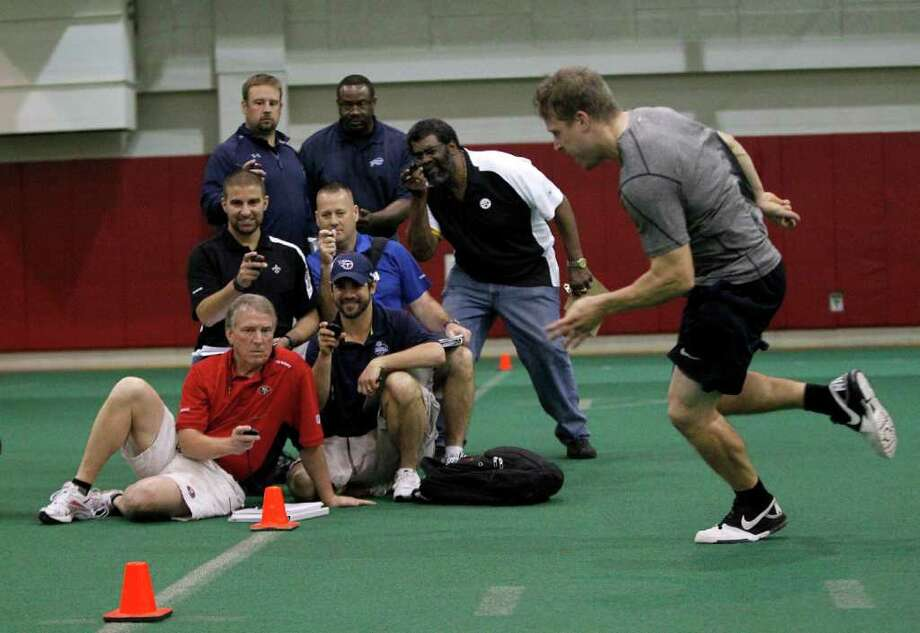 University of Houston's Case Keenum runs a drill for scouts who time him at the UH's Pro Day at  the Yeoman Fieldhouse inside the UH Athletics/Alumni Center Monday, March 19, 2012, in Houston. University of Houston quarterback Case Keenum, receiver Patrick Edwards and several other Cougars got the chance to showcase their skills for NFL scounts at UH's pro day. Photo: Karen Warren, Houston Chronicle / © 2012  Houston Chronicle