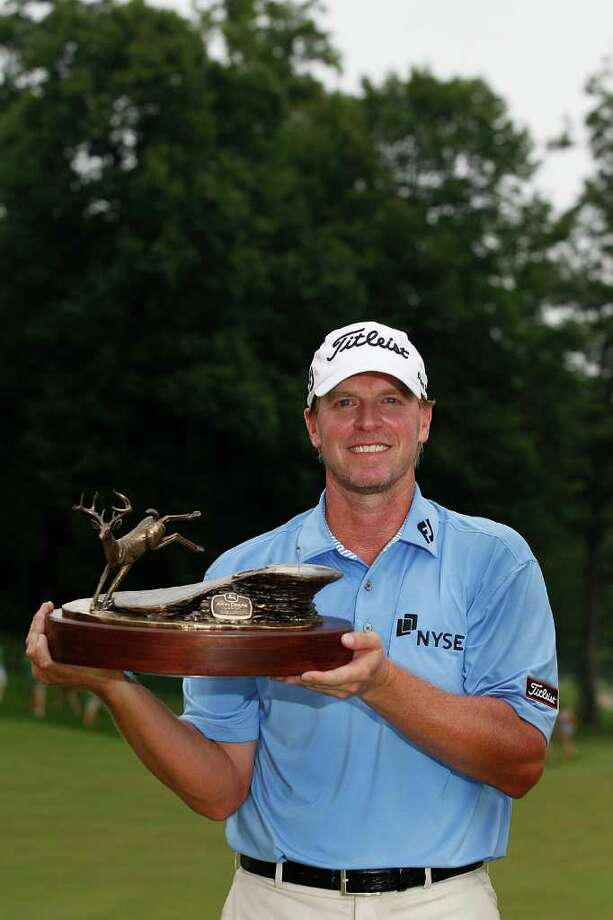 SILVIS, IL - JULY 10:  Steve Stricker holds the trophy after winning the John Deere Classic at TPC Deere Run on July 10, 2011 in Silvis, Illinois.  (Photo by Michael Cohen/Getty Images) Photo: Michael Cohen / 2011 Getty Images