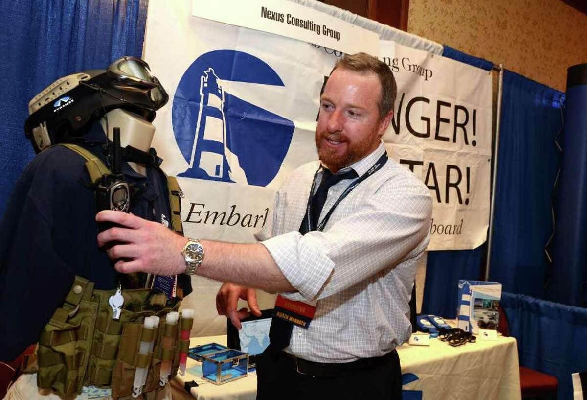 Kevin Doherty, President Nexus Consulting Group, an international security firm based out of Virginia, demonstrates simple security devices, such as radios and colored glow sticks, which are used to communicate in the event of a black out on ship during the Shipping 2012 Shippings and Trade Conference and Expo at the Stamford Hilton on Monday, Mar. 19, 2012. Doherty, a U.S. Marine, served in Virginia and Cuba from 1990-1994.