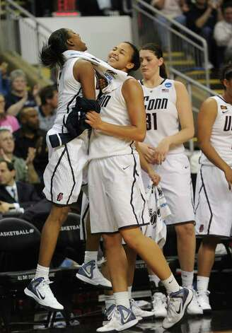 From left; UConn's Tiffany Hayes greets teammate Kiah Stokes as she heads to the bench in the final minutes of their victory over Kansas State in the second round of the NCAA women's basketball tournament at the Webster Bank Arena in Bridgeport on Monday, March 19, 2012. Photo: Brian A. Pounds / Connecticut Post