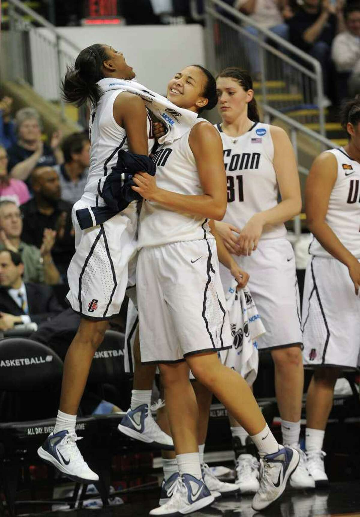 From left; UConn's Tiffany Hayes greets teammate Kiah Stokes as she heads to the bench in the final minutes of their victory over Kansas State in the second round of the NCAA women's basketball tournament at the Webster Bank Arena in Bridgeport on Monday, March 19, 2012.