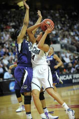 UConn's Bria Hartley drives to the basket against defender Mariah White during their victory over Kansas State in the second round of the NCAA women's basketball tournament at the Webster Bank Arena in Bridgeport on Monday, March 19, 2012. Photo: Brian A. Pounds / Connecticut Post