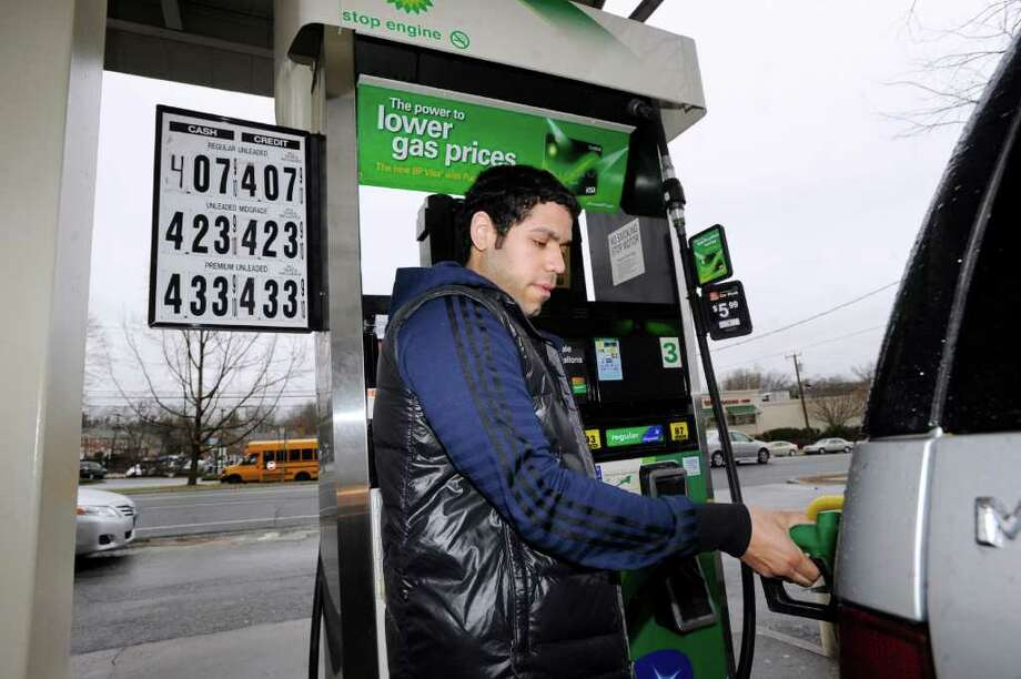 Greenwich native Steven Duque pumps gas at the Old Greenwich BP on the corner of East Putnam Avenue and Sound Beach Avenue March 1, 2012. Photo: Bob Luckey / Greenwich Time