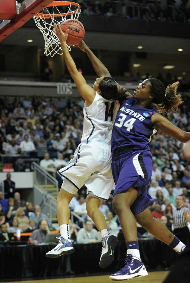 UConn's Bria Hartley is fouled by Kansas State's Branshea Brown as she drives to the basket during their victory in the second round of the NCAA women's basketball tournament at the Webster Bank Arena in Bridgeport on Monday, March 19, 2012. Photo: Brian A. Pounds / Connecticut Post
