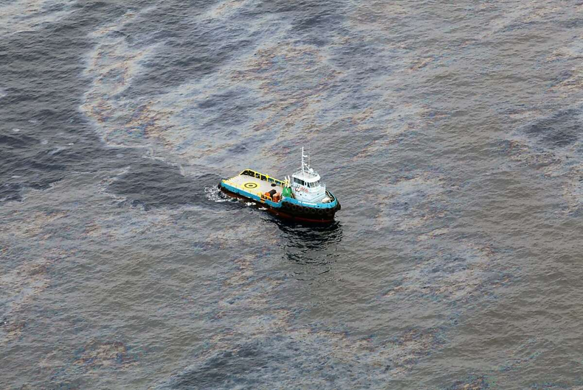 This photo taken Nov. 18, 2011 and released by Rio de Janeiro's government, shows an aerial view of a boat crossing an area of an oil spill in an offshore field operated by Chevron at the Bacia de Campos, in Rio de Janeiro state, Brazil. Rio de Janeiro state's environment secretary, Carlos Minc, says Brazil is expected to fine Chevron nearly $28 million for the ongoing offshore oil spill and will also ask Chevron to pay for damages caused by the Atlantic spill. Minc said Monday he considers the fine way too lenient, but it's the maximum allowed under current Brazilian law. (AP Photo/Rio de Janeiro's government,Rogerio Santana)
