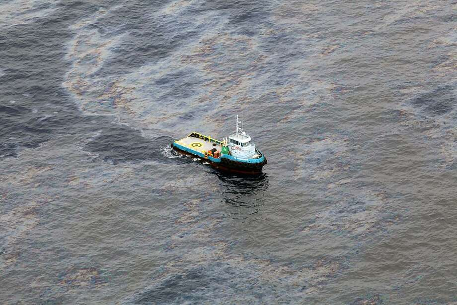 A boat traverses an oil spill in an offshore field run by Chevron in Rio de Janeiro state, Brazil. Photo: Rogerio Santana, Associated Press