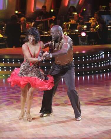 "Former NFL football star Emmitt Smith and Cheryle Burke perform on ""Dancing with the Stars"" in 2006. (ADAM LARKEY / AP)"