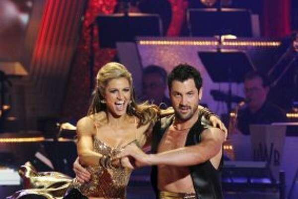 "Erin Andrews and partner Maksim Chmerkovskiy perform on ""Dancing With the Stars"" in 2010. (Adam Larkey / AP)"