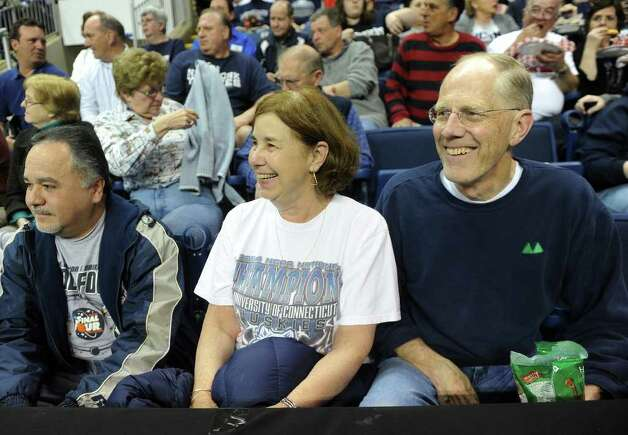 Suzanne and Alan Hale of Fairfield enjoy the game from the front row. UConn vs. Kansas State in the second round of the NCAA women's basketball tournament at the Webster Bank Arena in Bridgeport on Monday, March 19, 2012. Photo: Brian A. Pounds / Connecticut Post