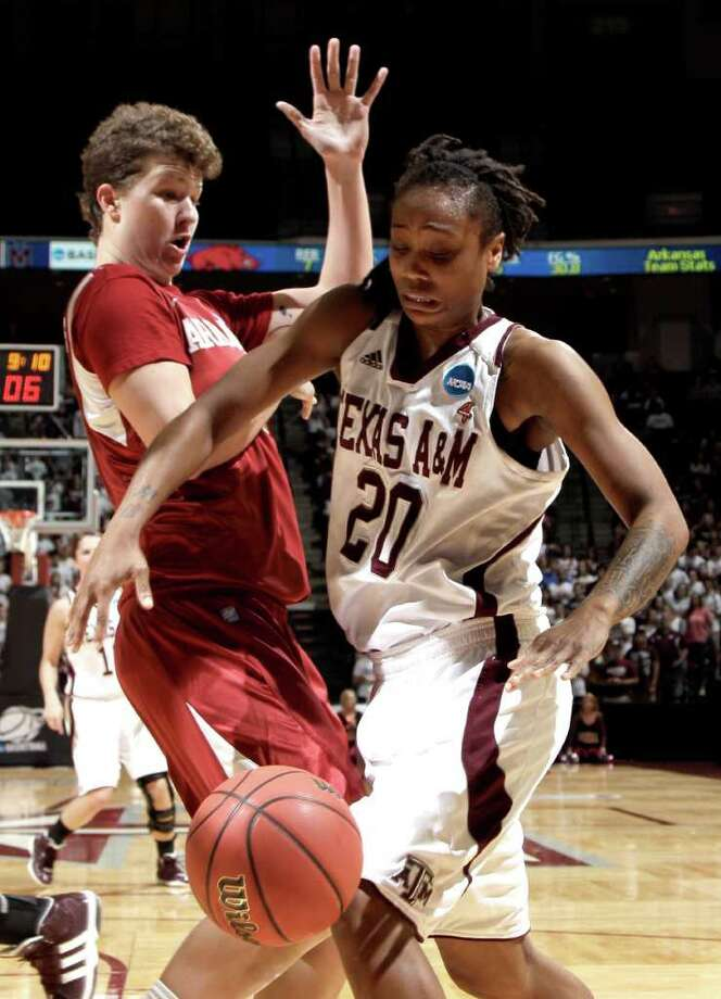 Arkansas' Sarah Watkins, left, knocks the ball loose from Texas A&M's Tyra White (20) during the first half of an NCAA tournament second-round women's college basketball game Monday, March 19, 2012, in College Station, Texas. (AP Photo/David J. Phillip Photo: David J. Phillip, Associated Press / AP