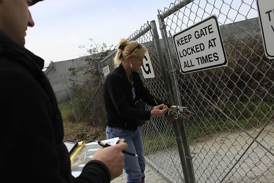 Karen Swaim, prinicipal/ herpetologist of Swaim Biological Inc., opens a gate at an area considered a sensitive habitat for the San Francisco garter snake and California red-legged frog at San Francisco International Airport's West-of-Bayshore property on Monday, March 19, 2012 in Millbrae, Calif. Photo: Lea Suzuki, The Chronicle