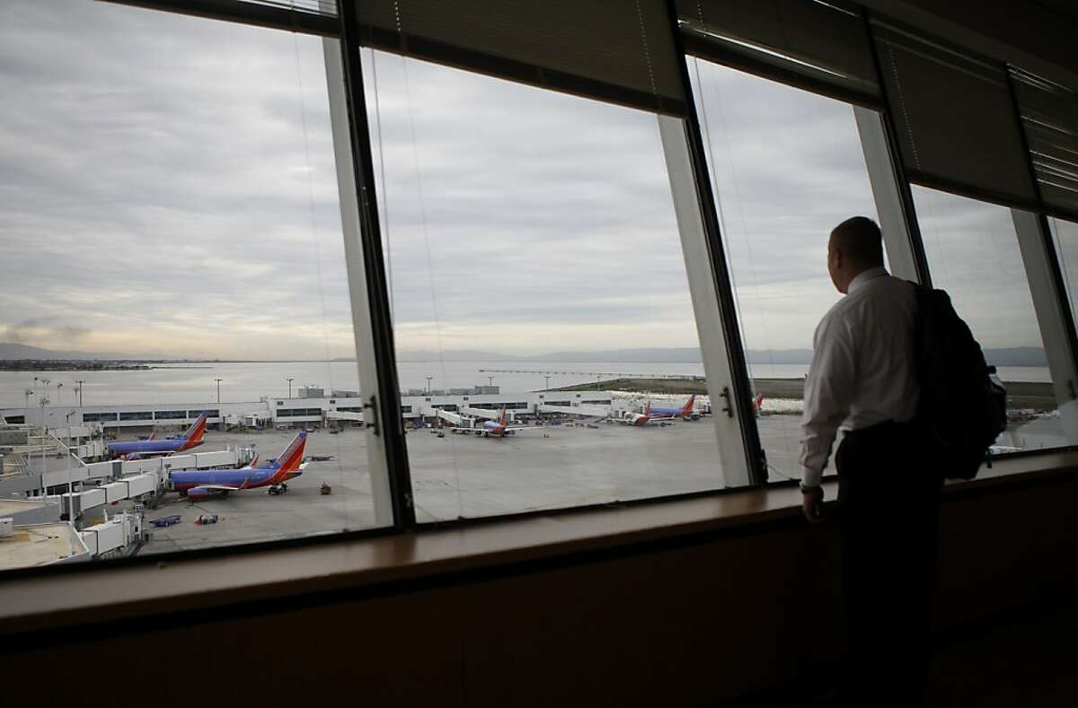 Chris Osterman with United Airlines looked down from the tower lounge at the traffic at the airport. The FAA's new Metroplex plan is a collaborative effort to make air traffic control more efficient, help airlines improve on-time performance and reduce emissions. Officials unveiled the program during a tour of Oakland Airport Monday March 20, 2012.