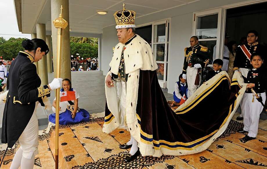(FILES) This file photo taken on August 1, 2008 shows the newly crowned King Siaosi (George) Tupou V of Tonga wears a maroon-coloured cape trimmed with white ermine fur and a three metre-long train carried by child pages as he emerges from his lavish Christian coronation ceremony at the Centenary Free Wesleyan Church in Nuku'alofa.  The death of the king of Tonga George Tupou V was officially announced on March 19, 2012 in an address to the nation by Prime Minister Lord Tu'ivakano, a senior government source told AFP. Tu'ivakano confirmed reports that the king had died on Sunday in a Tongan language statement on public radio, said the source, who wished to remain anonymous and declined to provide further details.    AFP PHOTO / Peter HALMAGYI / FILES (Photo credit should read PETER HALMAGYI/AFP/Getty Images) Photo: Peter Halmagyi, AFP/Getty Images