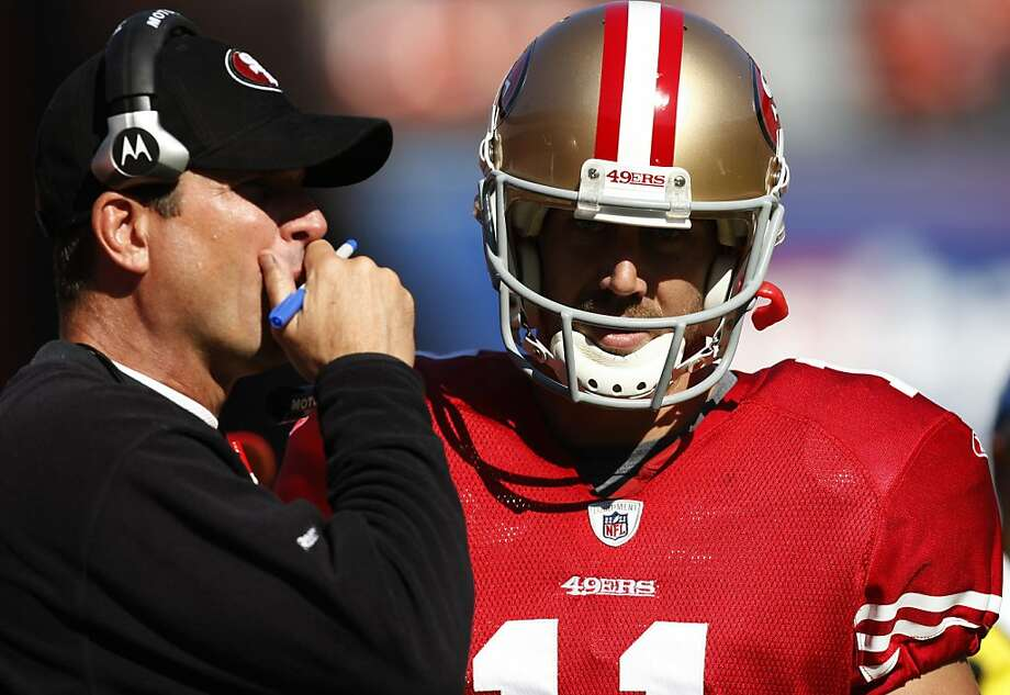 San Francisco 49ers quarterback Alex Smith (right) confers with Head Coach Jim Harbaugh during a timeout against the Cleveland Browns at Candlestick Park in San Francisco, Calif., on Sunday, Oct. 30, 2011.    The 49ers beat the Browns, 20-10. Photo: Dylan Entelis, The Chronicle