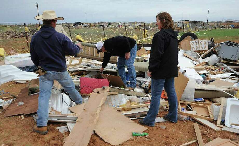 Residents search through debris after a Monday storm passed through Gardendale, north of Odessa. A tornado also reportedly touched down near Lytle, 25 miles southwest of San Antonio, Monday night. Photo: Mark Sterkel / Odessa American`