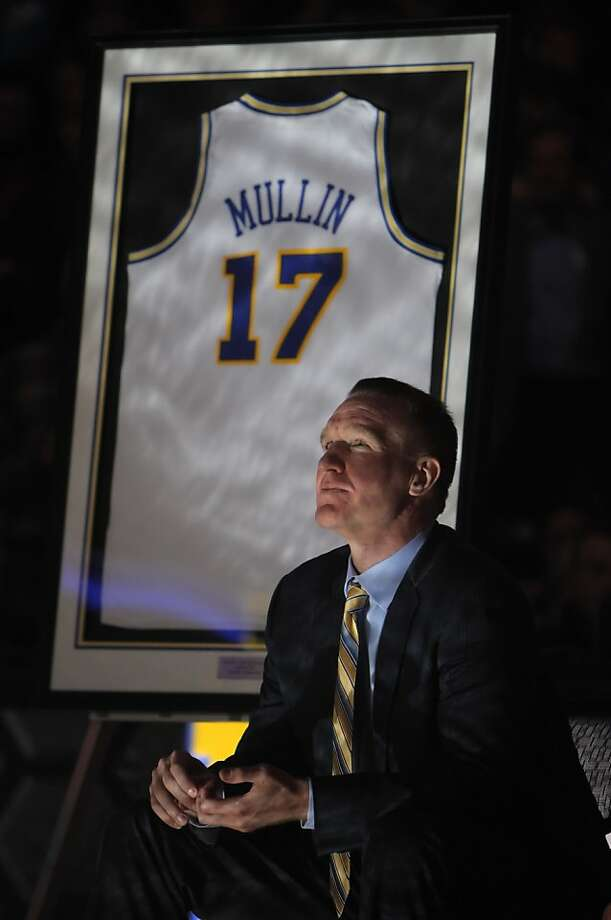 Chris Mullin watches a video tribute to his days playing for the Warriors. The Hall of Famer had his jersey retired at a halftime ceremony during the Warriors game against the Minnesota Timberwolves at Oracle Arena in Oakland, Calif., on Monday, March 19, 2012. Photo: Carlos Avila Gonzalez, The Chronicle