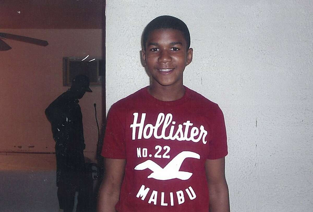 In this undated file family photo, Trayvon Martin poses for a family photo. College students around Florida rallied Monday, March 19, 2012, to demand the arrest of a white neighborhood watch captain who shot unarmed teen Martin last month, though authorities may be hamstrung by a state law that allows people to defend themselves with deadly force.