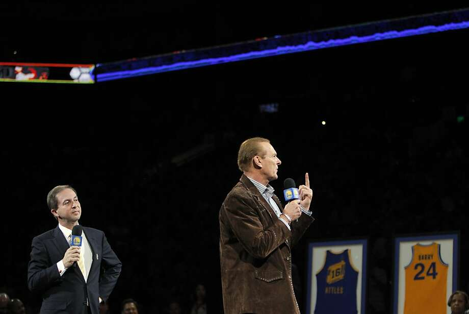 Rick Barry, right, tries to stop the crowd from booing Warriors owner Joe Lacob during a halftime ceremy retiring the jersey of Warriors Hall of Famer, Chris Mullin at Oracle Arena in Oakland, Calif., on Monday, March 19, 2012. Photo: Carlos Avila Gonzalez, The Chronicle