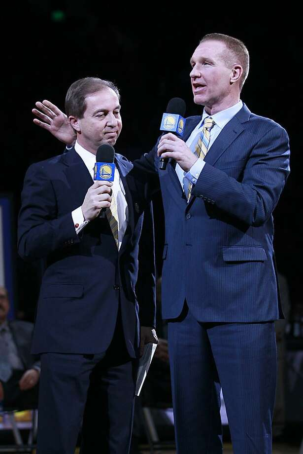 Former Golden State Warriors player Chris Mullin, right, speaks next to majority owner Joe Lacob during a ceremony at halftime of an NBA basketball game between the and the Minnesota Timberwolves in Oakland, Calif., Monday, March 19, 2012. The Warriors retired Mullin's No. 17 jersey during a halftime ceremony. Photo: Jeff Chiu, Associated Press