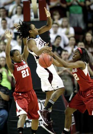 Arkansas' C'eira Ricketts (22) grabs the ball away from Texas A&M's Tyra White, center, as Dominique Robinson (21) defends during the second half of an NCAA tournament second-round women's college basketball game Monday, March 19, 2012, in College Station. Texas A&M beat Arkansas 61-59. Photo: Associated Press