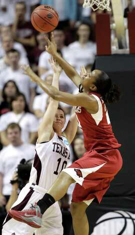 Texas A&M's Alexia Standish (10) goes up to block the shot of Arkansas' Dominique Robinson (21) during the first half of an NCAA tournament second-round women's college basketball game Monday, March 19, 2012, in College Station. Photo: Associated Press