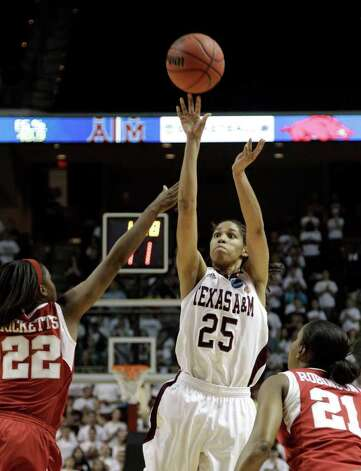 Texas A&M's Skylar Collins (25) shoots as Arkansas' C'eira Ricketts (22) and Dominique Robinson (21) defend during the first half of an NCAA tournament second-round women's college basketball game Monday, March 19, 2012, in College Station. Photo: Associated Press