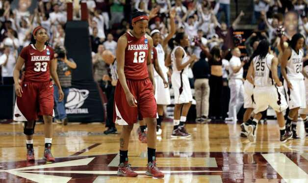 Arkansas' Ashley Daniels (12) and Lyndsay Harris walk off the court after Texas A&M's 61-59 win in an NCAA tournament second-round women's college basketball game Monday, March 19, 2012, in College Station. Photo: Associated Press