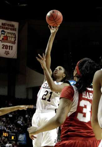 Texas A&M's Adaora Elonu (21) shoots as Arkansas' Lyndsay Harris (33) watches during the first half of an NCAA tournament second-round women's college basketball game Monday, March 19, 2012, in College Station. Texas A&M won 61-59. Photo: Associated Press