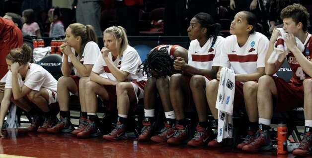 Arkansas players sit on the bench during the closing seconds of an NCAA tournament second-round women's college basketball game against Texas A&M on Monday, March 19, 2012, in College Station. Texas A&M beat Arkansas 61-59. Photo: Associated Press