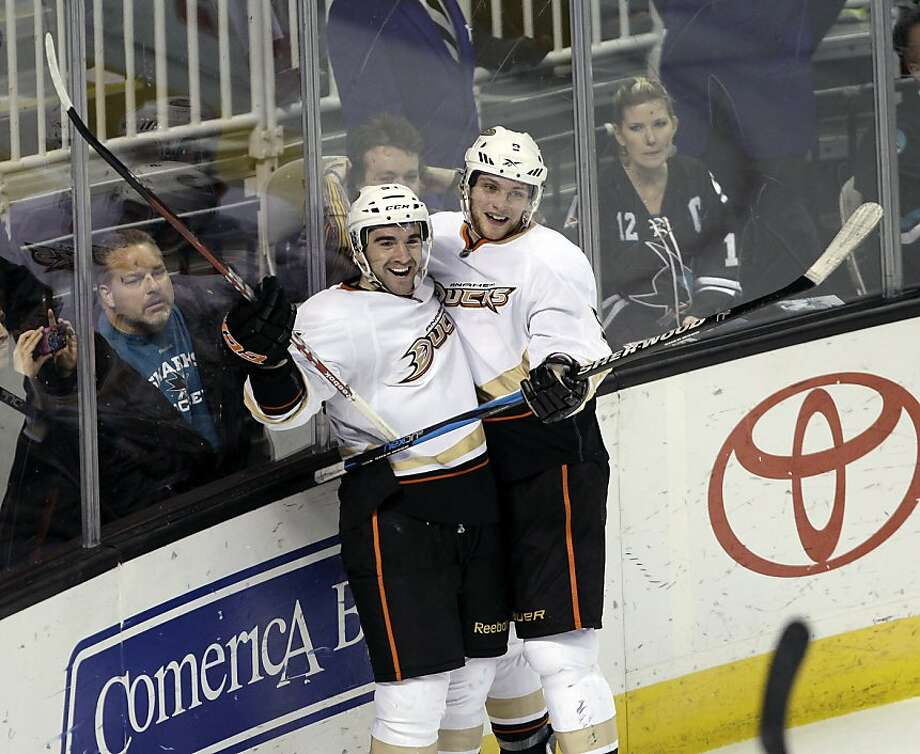 Anaheim Ducks right wing Kyle Palmieri, left, is congratulated by left wing Bobby Ryan, right, after scoring past the San Jose Sharks in the second period of an NHL hockey game in San Jose, Calif., Monday, March 19, 2012. (AP Photo/Paul Sakuma) Photo: Paul Sakuma, Associated Press