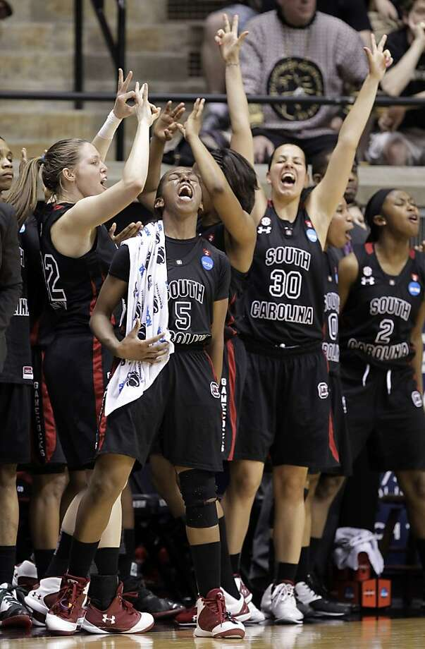 South Carolina players, including Markeshia Grant (5), Pamela Decheva (30) and Shelbretta Ball (2), celebrate during the second half of an NCAA tournament second-round women's college basketball game against Purdue in West Lafayette, Ind., Monday, March 19, 2012. South Carolina defeated Purdue 72-61. (AP Photo/Michael Conroy) Photo: Michael Conroy, Associated Press