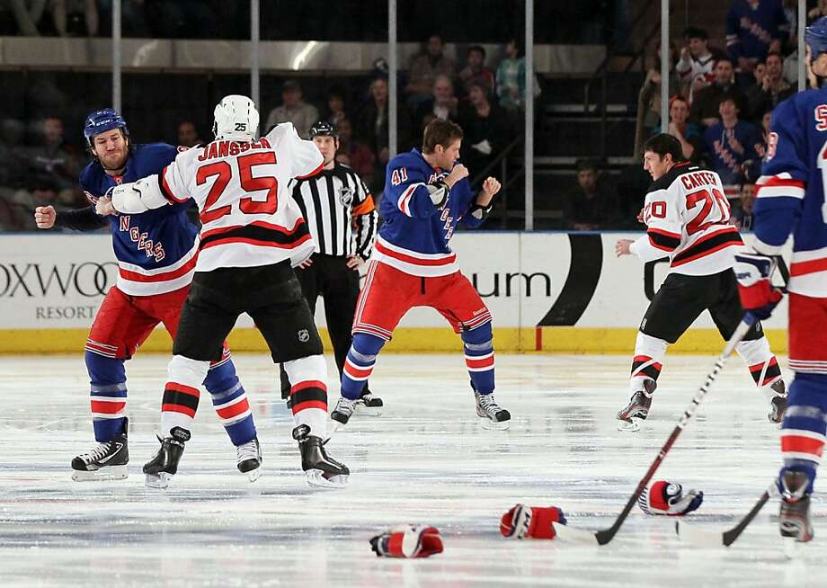 Brandon Prust (8) of the New York Rangers fights Cam Janssen (25) of the New Jersey Devils as Stu Bickel (41) of the New York Rangers fights Ryan Carter (20) of the New Jersey Devils three seconds into the game on Monday, March 19, 2012, at Madison Square Garden in New York. (Jim McIsaac/Newsday/MCT) Photo: Jim McIsaac, McClatchy-Tribune News Service