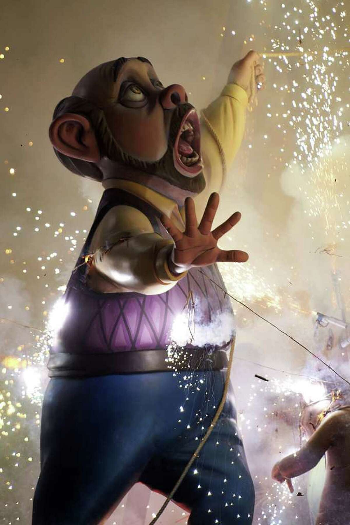 VALENCIA, SPAIN - MARCH 19: A combustible 'Ninot' caricatures burn during the last day of the 'Fallas' festival on March 19, 2012 in Valencia, Spain. The festival, which runs March 15 - 19, celebrates the arrival of spring with fireworks, fiestas and bonfires.