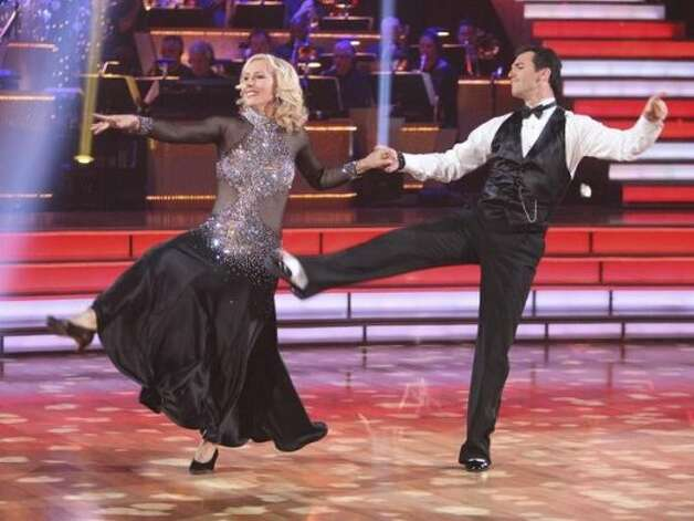 "DANCING WITH THE STARS - ""Episode 1401"" -- This season's spectacular new cast of celebrities brought the glamour, the glitter and -- most importantly - the savvy dance moves during the two-hour Season 14 premiere of ""Dancing with the Stars,"" MONDAY, MARCH 19 (8:00-10:01 p.m., ET) on the ABC Television Network. Dancing either the Foxtrot or the Cha Cha, the couples surprised audiences with exciting performances throughout the evening when they hit the ballroom floor for the first time on live national television. (ABC/ADAM TAYLOR) MARTINA NAVRATILOVA, TONY DOVOLANI (ABC)"