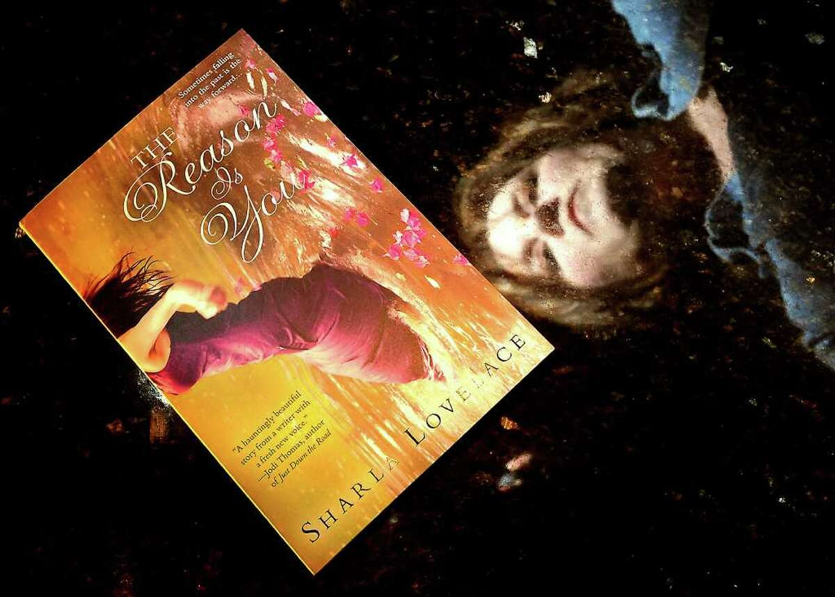 """Port Neches resident, Sharla Lovelace is the author of the paranormal romance novel, """"The Reason Is You"""", Thursday, March 15, 2012. Tammy McKinley/The Enterprise"""