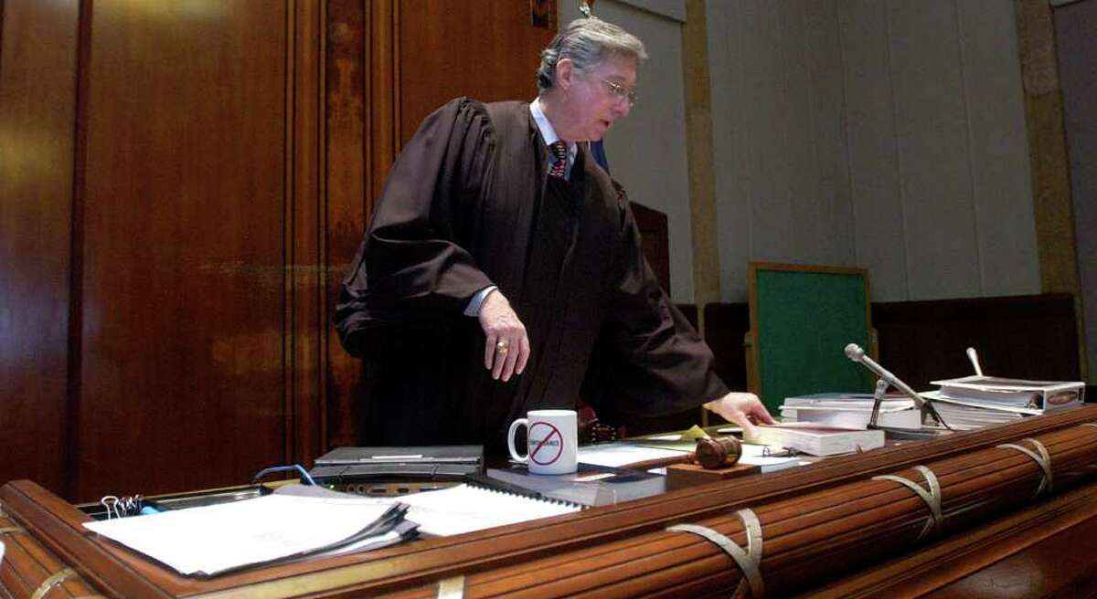 Larry Thorne, Judge of the 317th Family Law Court of Jefferson County prepares to sit at his bench during a 2007 court case. Enterprise file photo