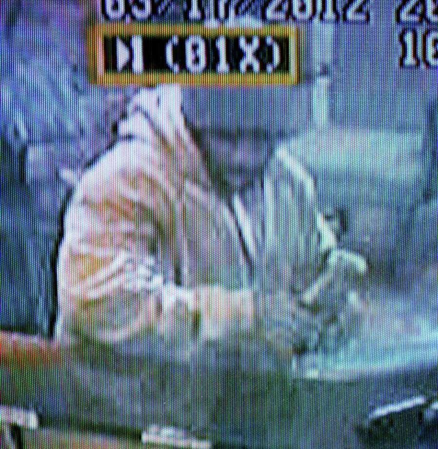 This surveillance camera image of a man sought for the knifepoint robbery of receipts at the Best Western Motel on Saturday was released by Fairfield police on Tuesday. Photo: Fairfield Police Department / Fairfield Citizen contributed